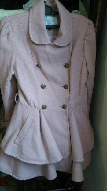 abrigo color palo de rosa de lana