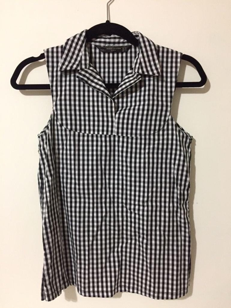 Blusa de cuadros con cuello