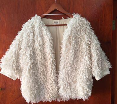 Abrigo color hueso